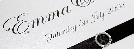 A black tie and diamonds wedding table plan using circular diamante buckles